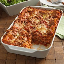 Cheesy Beef Lasagna Recipe - Hearty lasagna recipe with a ground beef meat sauce and three cheeses layered with uncooked lasagna noodles to save some work.