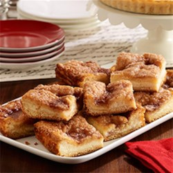 PAM(R) Sopapilla Cheesecake Pie Recipe - Puffy layers of crescent dough with a cream cheese filling are topped with cinnamon sugar for an easy, elegant dessert.