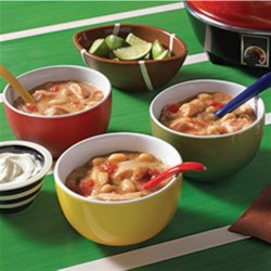 Slow Cooker White Chicken Chili Recipe - A slow cooker recipe for white chicken chili assembled quickly with chicken thighs, canned beans and zesty tomatoes.