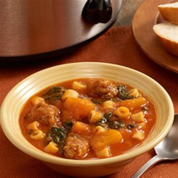 Slow Cooker Butternut Squash Soup with Sausage Recipe - Hearty slow cooker soup recipe full of butternut squash, Italian sausage, spinach and small pasta.