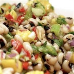 Texas Caviar Recipe - Black-eyed peas, bell peppers, and onion are the base of this Texas caviar recipe with plenty of flavor from herbs and spices.