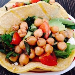 Garbanzo Bean Mint Tacos Recipe - Garbanzo beans, mint, olives, and balsamic vinegar give a refreshing summery twist to traditional tacos.