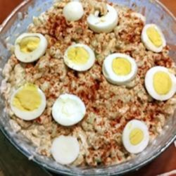 My Mom's Awesome Macaroni Salad (enough to feed a crowd!) Recipe - This macaroni salad is given added depth with the addition of tuna, shrimp, cucumber, and hard-cooked eggs.