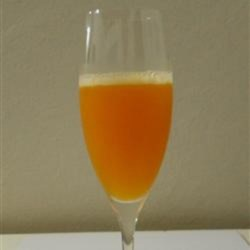 Paraguay Passion Recipe - Dark rum, triple sec, and passion fruit juice are shaken together and poured into a champagne glass creating a tropical and fruity cocktail.