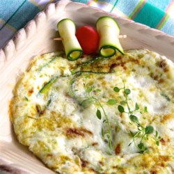 Zucchini Egg White Frittata Recipe - Zucchini and shallots are pan-fried with thyme-scented egg whites for a quick and easy frittata perfect for breakfast, lunch, or dinner.