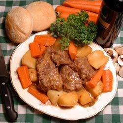 Oven Pot Roast Recipe and Video - This simple pot roast -  browned in butter and baked in mushroom soup and vermouth - makes delicious gravy while it's cooking.