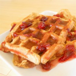 Sweet Potato Waffles with Cranberry Maple Syrup Recipe - These flavorful sweet potato waffles, topped with cranberry maple syrup, make a deliciously festive breakfast.