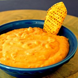 Fiesta Bean Dip Recipe - This four-ingredient recipe turns canned nacho cheese soup, refried beans, salsa, and sour cream into a deliciously creamy warm party dip.