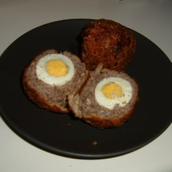 Scotch Eggs Recipe - Here is an old family recipe for this hearty egg and sausage dish. This dish is high in fat so it's best if eaten only as a special treat