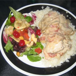 Deluxe Sour Cream Chicken Recipe - Chicken breasts baked with bacon and a sour cream mixture, served over hot cooked rice.