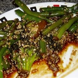 Garlicky, Spicy and Sesamey Green Beans Recipe - Always looking for a way to make green beans different, this one is such a winner. Green beans are sauteed with garlic, shallot and sesame seeds for a tasty side dish with Asian flair.
