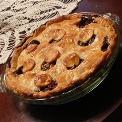 Meatless Mincemeat Pie Recipe - Take some prepared mincemeat and stir in walnuts, diced apples, brown sugar, lemon juice and brandy. This rich filling is chilled overnight and then piled into a prepared crust, topped with a lattice crust, and baked.
