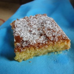 Ooey Gooey Butter Cake Recipe - Butter cake topped with a cream cheese layer is baked into an ooey gooey cake that you can't resist!