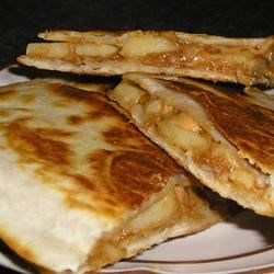 Peanut Butter Fiend Quesadillas Recipe - Here's a simple and delicious late-night (or anytime) snack. Peanut butter and apple slices are grilled between flour tortillas. Try it with bananas or other thinly sliced fruit.