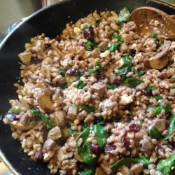 Farro, Sausage, and Spinach Dinner Recipe - Chicken sausage is pan-fried with farro, spinach, goat cheese, and a cherry sauce for a hearty and flavorful dish.