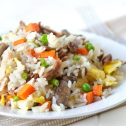 Pork Fried Rice Recipe and Video - This is a quick and easy way to enjoy stir-fried rice with pork and vegetables at home.