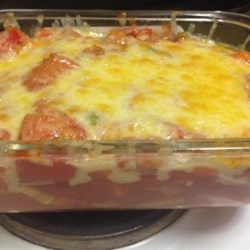 Hot Dog Casserole Recipe - Sliced hot dogs are baked with canned green beans and stewed tomatoes, then topped with mozzarella cheese and broiled until bubbling. Try it on your picky kids.
