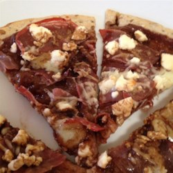Fig and Prosciutto Pizza Recipe - Fig and prosciutto pizza with feta cheese and a drizzle of olive oil is a quick and easy recipe that makes a fancy any-time meal.
