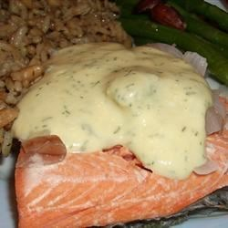Quick Poached Salmon with Dill Mustard Sauce Recipe - A yogurt dill sauce is a cool, creamy counterpart to salmon poached in a delicate white wine and shallot broth.