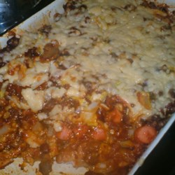 Chili Dog Casserole I Recipe - My cousin Donna made up this recipe several years ago and it's one my children love. It's like eating a chili dog, but with a fork.