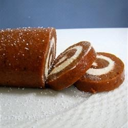 Granny Kat's Pumpkin Roll Recipe - A sweetly spicy, pumpkin-flavored cake is spread with a silky rich cream cheese filling and rolled up like a pinwheel. For easy lifting, line your baking pan with parchment paper. Chill the cake to set before slicing.
