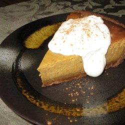 Poetic Pumpkin Pie Recipe - Pumpkin pie gets a little more poetic when you bake it in a cinnamon-based crust and top it with sweet brown sugar whipped cream.