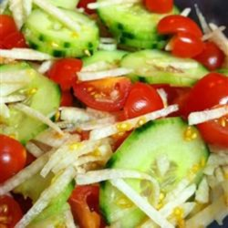 Summer Cucumber Jicama Salad Recipe - This refreshing cucumber, tomato, and jicama salad is a crowd-pleasing, quick-and-easy starter for a summer meal.