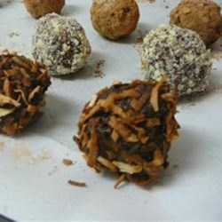 Vegan Truffles - Toasted Coconut Recipe - Make homemade vegan truffles made with Medjool dates, almonds, and coconut for a tasty, quick-and-easy treat.
