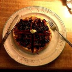 Whole Grain Waffles with Blackberry Sauce Recipe - Whole wheat waffles with a homemade blackberry sauce are a hearty and filling way to start the day.