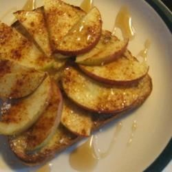Apple Toast Recipe - A great, light, after-school snack for kids that is easy to make. Sliced apples are placed on buttered bread, then sprinkled with cinnamon and quickly broiled.