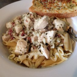 Penne with Chicken and Pesto Recipe - This is a quick and easy dish in which penne pasta is tossed with chicken in a simple sauce of cream, pesto and Parmesan cheese.