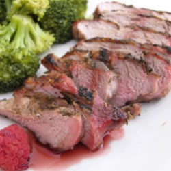 Pork Chops with Raspberry Sauce Recipe - Succulent herbed boneless pork loin chops paired with a tangy raspberry sauce ... heaven on a plate! This is a special family dish or perfect for company. I accompanied it with mashed potatoes and julienned steamed carrots. My husband can't wait to have it again.