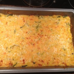 Cheesy Zucchini Rice Bake Recipe - This recipe delivers a big casserole of rice, cheese, and zucchini for a comforting dish everyone will enjoy.