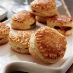 French Onion Soup Puffs Recipe - Caramelized onions, thyme, and Gruyere cheese fill golden rounds of puff pastry with the flavours of French onion soup.