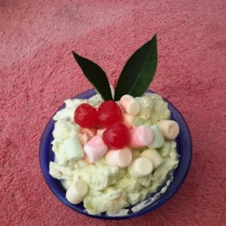 Pistachio Salad Recipe - Instant pistachio pudding mix is combined with whipped topping, miniature marshmallows, crushed pineapple,  nuts, and sliced bananas in this salad which can be served with as dessert or with a ham dinner.