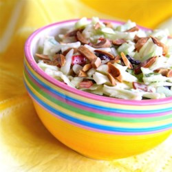 Mikes' Coleslaw Recipe - This quick and easy recipe for coleslaw contains almonds, cranberries, celery, peppers, and onions.