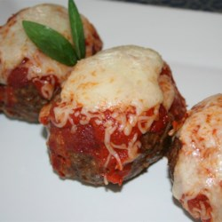 Italian Mini Meat Loaves Recipe - Lots of cheese and four-cheese red sauce make these flavorful Italian-inspired mini meat loaves a new family favorite.