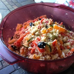 Jen's Greek Couscous Salad Recipe - This mixture of Israeli couscous, tomatoes, olives, bell pepper, and feta cheese in a lemon juice dressing delivers a taste of Greece to your table.