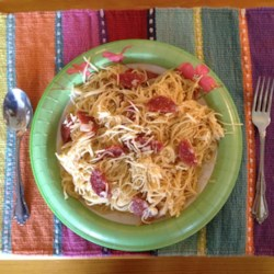 Sauceless Spaghetti Recipe - A fresh saute of bell peppers and onions gets a spicy lift from slices of pepperoni. Stir into angel hair pasta and grated mozzarella and Parmesan cheese, then bake until the cheeses melt.