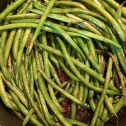 Citrus-Bacon Green Beans Recipe - Brighten up your green beans by simmering them in butter with lemon, lime, and bacon bits!