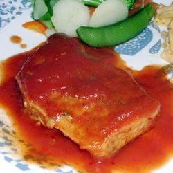 Baked Pork Chops II Recipe - A sweet tomato sauce is great with thick baked pork chops!