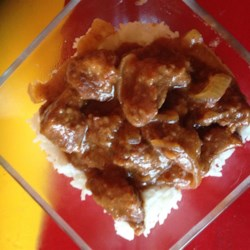 Sweet and Sour Beef Cubes Recipe - Cubes of beef baked under onion in a mixture of ketchup, vinegar, and soy sauce makes a great topping for rice.
