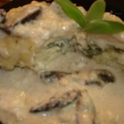 Mushroom Chicken Parmesan Recipe -  Mushrooms add an earthy note to this traditional, creamy dish.