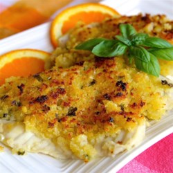Orange Tilapia Recipe - The tilapia fillets in this recipe are marinated and baked in orange juice and topped with a mixture of butter, bread crumbs, garlic, and basil.