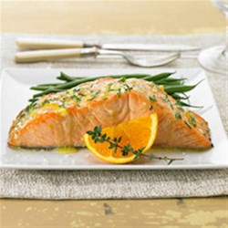 Herbed Citrus Salmon Recipe - Salmon fillets are marinated in an orange-thyme mixture, baked until tender, then topped with citrus-herb butter.