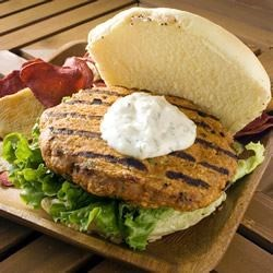 Thai Chicken Burgers Recipe - Perfect for a more exotic barbecue, these Thai-inspired chicken burgers combine ground chicken with sweet, tangy peanut sauce and red curry paste.  Barbecue or pan-cook, and serve with coconut-mint mayo on toasted rolls.