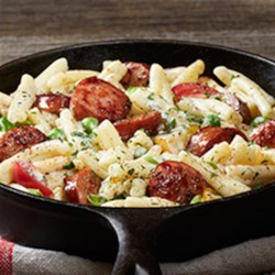 Hillshire Farm(R) Sausage Alfredo Recipe - This creamy pasta and sausage dinner gets some heat from Cajun seasoning, and it's ready to serve in 15 minutes.