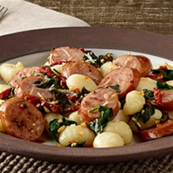 Smoked Sausage Gnocchi with Sun-Dried Tomatoes Recipe - Prepared gnocchi with smoked sausage, sun-dried tomatoes and spinach is topped with Parmesan cheese for a quick and delicious weeknight meal.