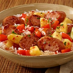 Hawaiian Pineapple Sweet & Sour Smoked Sausage Recipe - Sauteed smoked sausage, red bell pepper, and fresh pineapple with sweet chili garlic sauce are served over hot cooked rice.