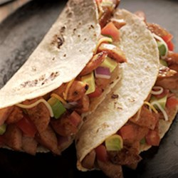 Smoked Sausage Tacos Recipe - Slices of smoked sausage with taco seasoning make delicious tacos topped with any or all of your favorites--avocado tomato salsa, shredded cheese, jalapenos, and more!